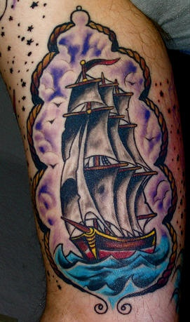 Old school pirate ship tattoo in colour