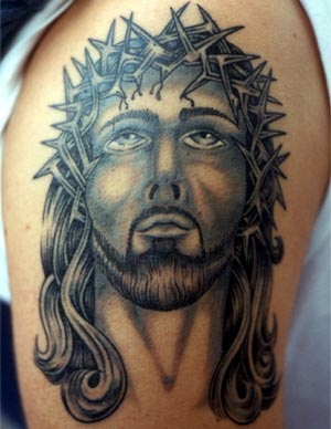 Old school tattoo with jesus face