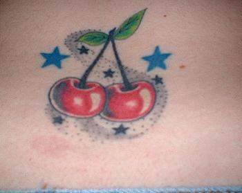 Old school tattoo design with red cherry and blue stars