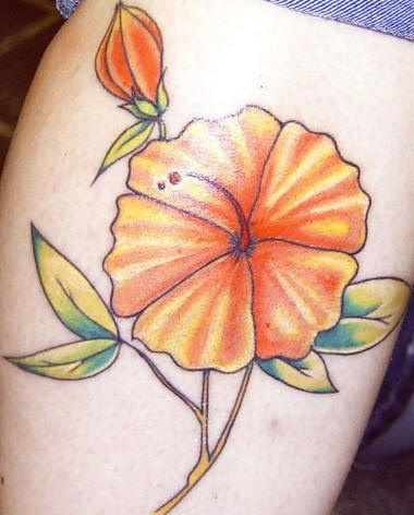 Orange hibiscus blossom tattoo