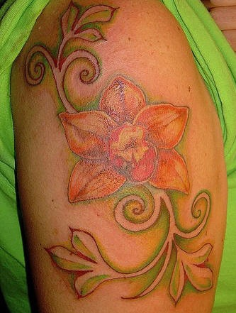 Orange orchid with tracery tattoo