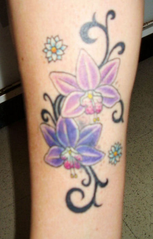 Orchid flowers and tribal tracery tattoo