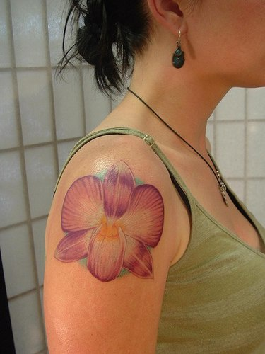 Realistic orchid flower tattoo on shoulder