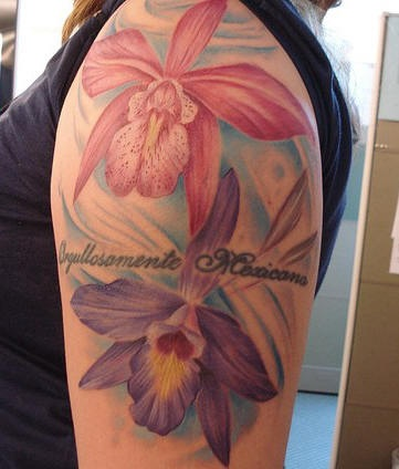 Detailed orchid flowers arm tattoo