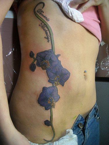 Purple orchid flowers tattoo on side