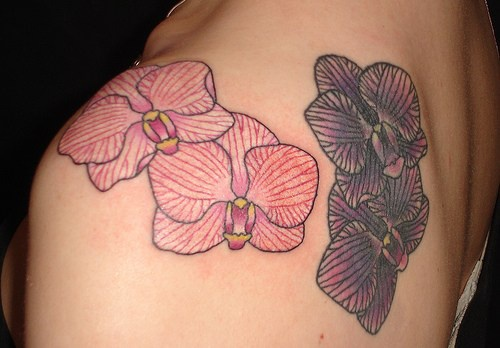 Minimalistic red and black orchids tattoo