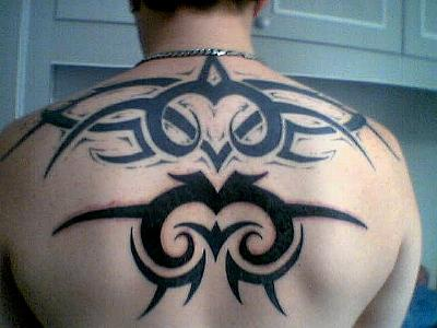 Traditional back tattoo with black signs