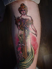 Traditional colored tattoo of beautiful greek lady with flowers