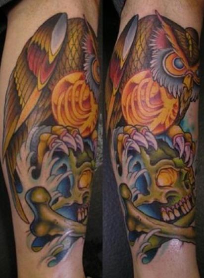Leg tattoo, colourful  owl is sitting on skull