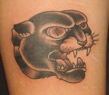 Panther head black ink tattoo