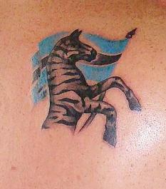 Patriotic zebra and flag tattoo