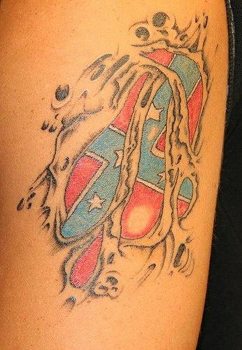 Confederate flag under skin rip tattoo