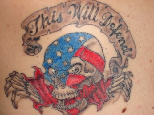 Skull in american flag colour tattoo