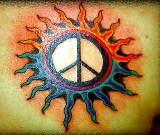 Peace sign in sun tattoo