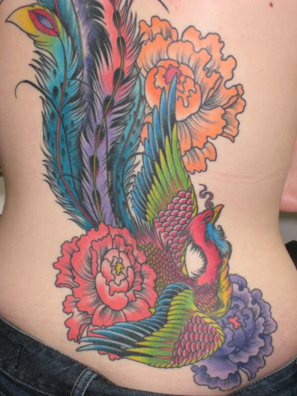 Colourful magic bird with flowers tattoo