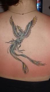 Colourful magic phoenix tattoo