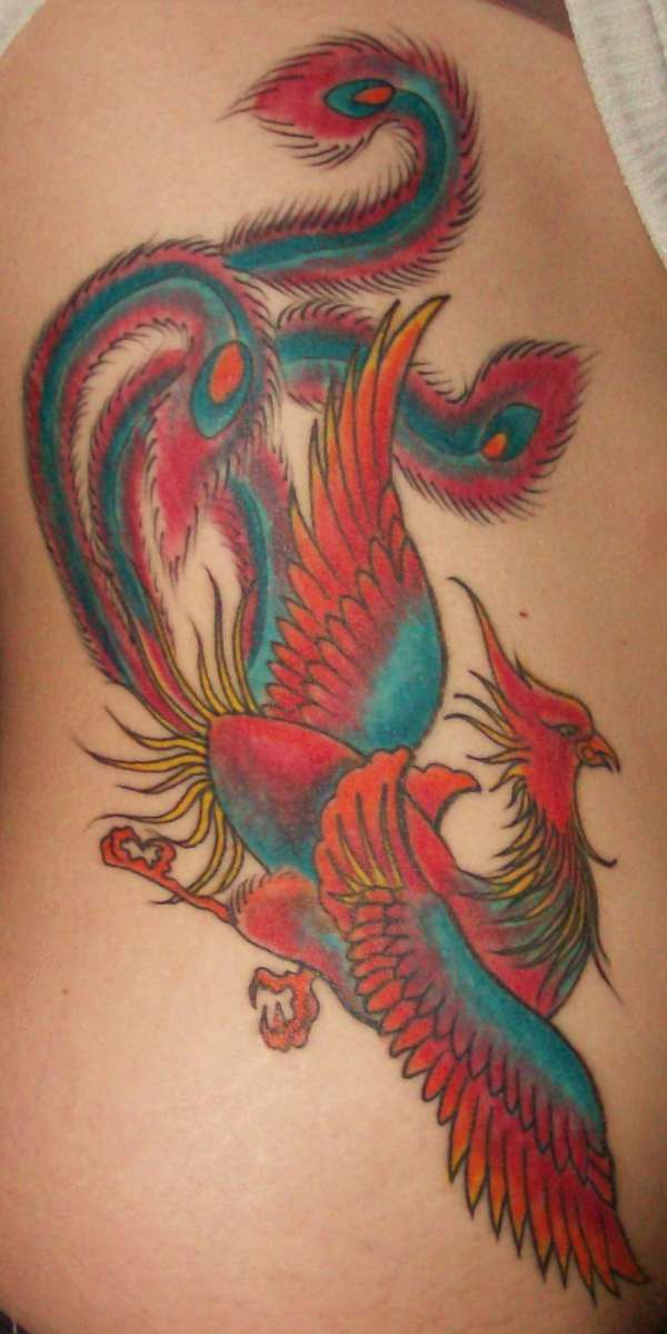Colourful red and blue magic bird tattoo