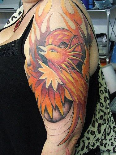 Phoenix artwork tattoo on arm