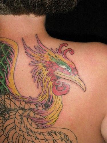 Colourful phoenix head tattoo