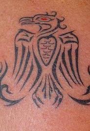 Tribal phoenix symbol tattoo