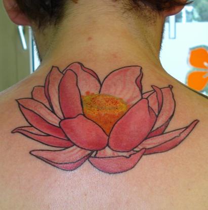 Pink lotus flower tattoo on back