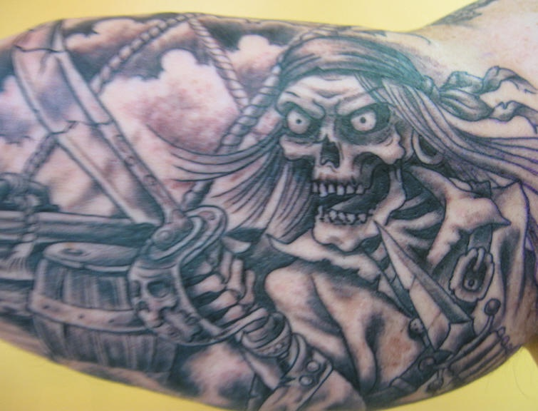 Angry pirate skeleton on deck tattoo