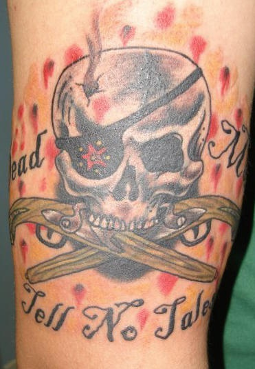Pirate skull with crossed muskets tattoo