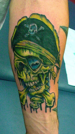 Green pirate skull with crossed bones tattoo