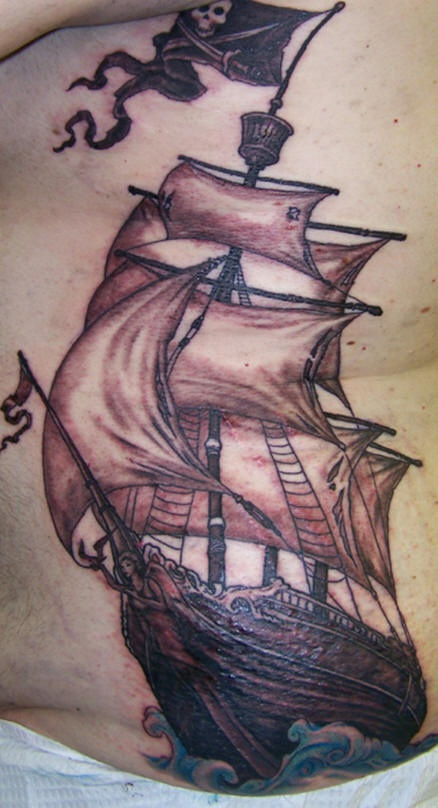 Highly detailed pirate ship tattoo