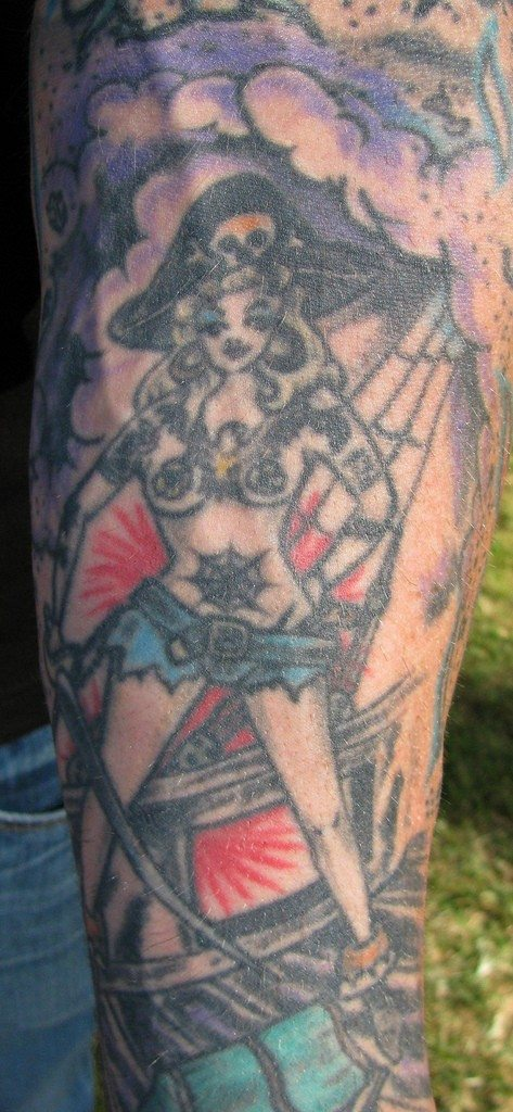 Pirate wench and ship tattoo