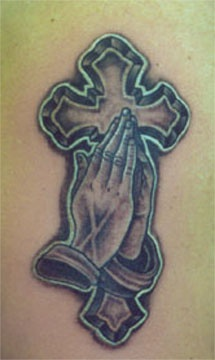 Praying hands and large cross tattoo