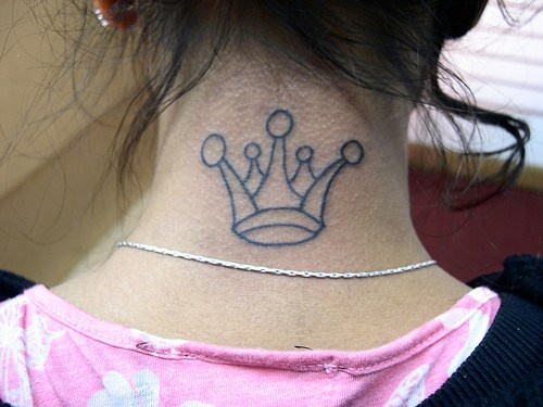 Princess crown tattoo on neck