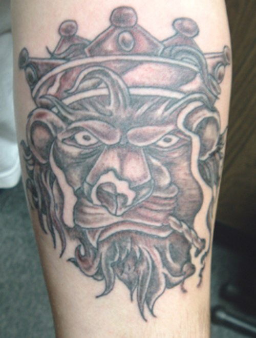 Crowned lion smoking weed tattoo