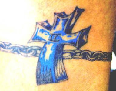 Blue cross on armband tattoo