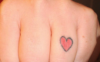 Finger tattoo,little simple red heart
