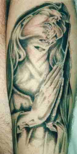 Praying zombie nun tattoo