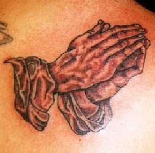 Old man praying hands tattoo