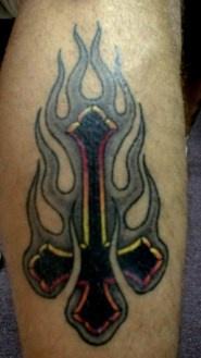 Petrine Cross in black tribal flame tattoo