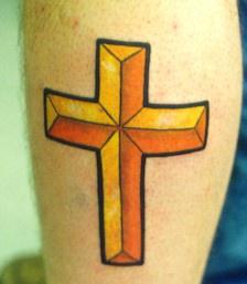 Golden latin cross tattoo