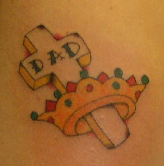 Cross and golden crown tattoo