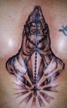 Mani mentre preghiera tatuaggio