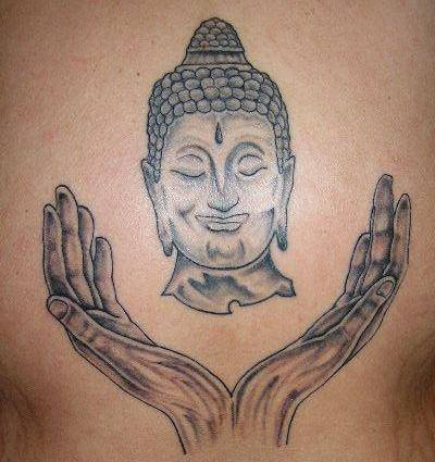 Buddha head and hands tattoo