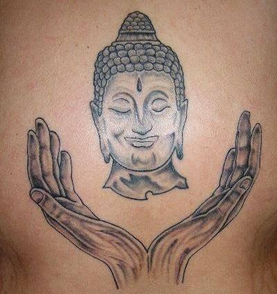 Testa di buddha e mani tatuaggio