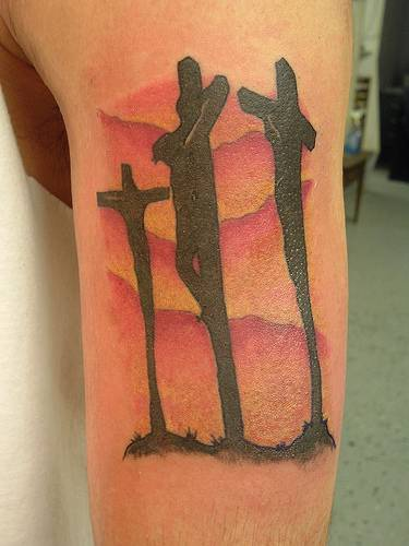 Surreal Calvary cross tattoo