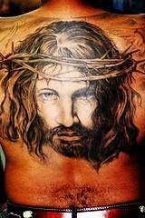 Large jesus portrait tattoo on back