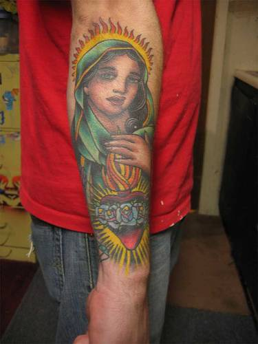 Mary de Guadalupe coloured arm tattoo