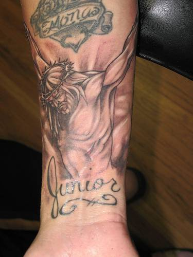 Jesus crucifixion tattoo on arm