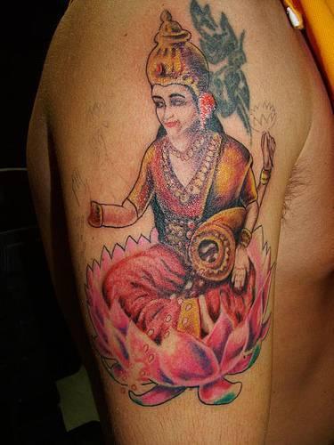 Hindu deity on lotus tattoo