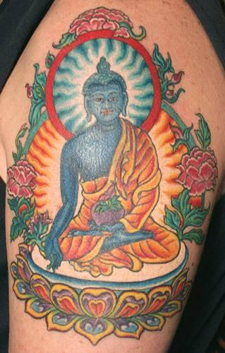 Blue meditating buddha coloured tattoo
