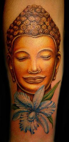 Golden buddha head and flower tattoo